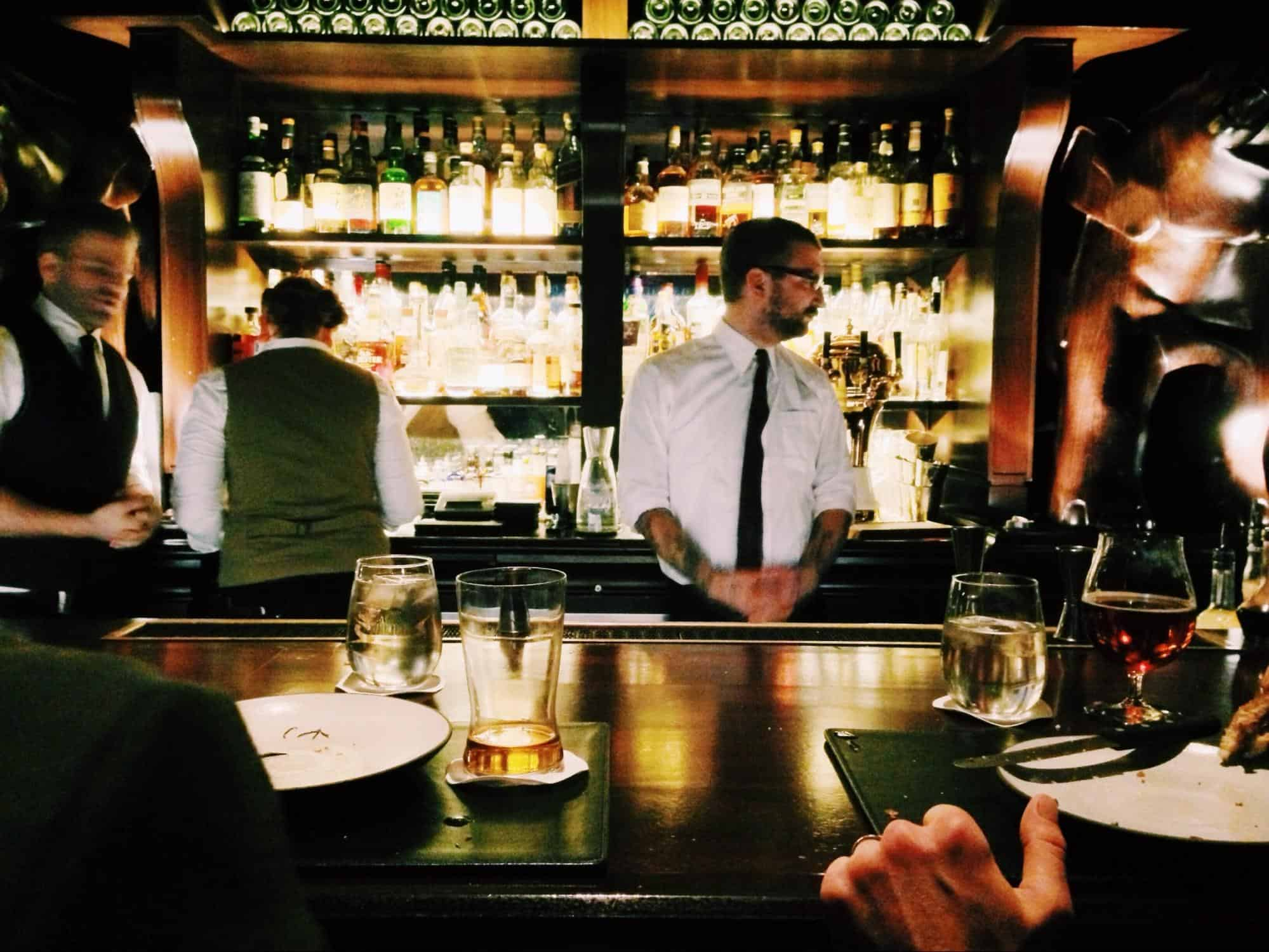 Man in front of bar