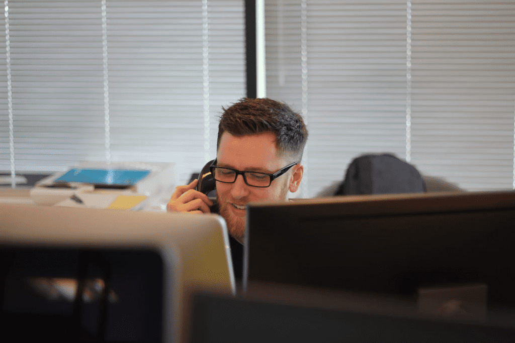 man working in call center management