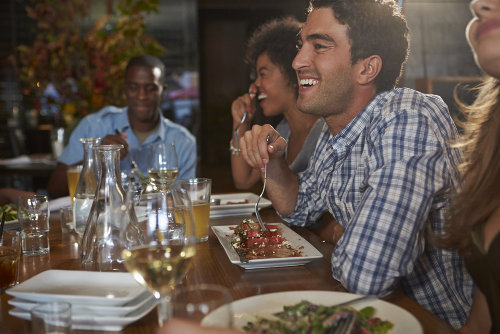 Happy diners as a result of good restaurant management tips