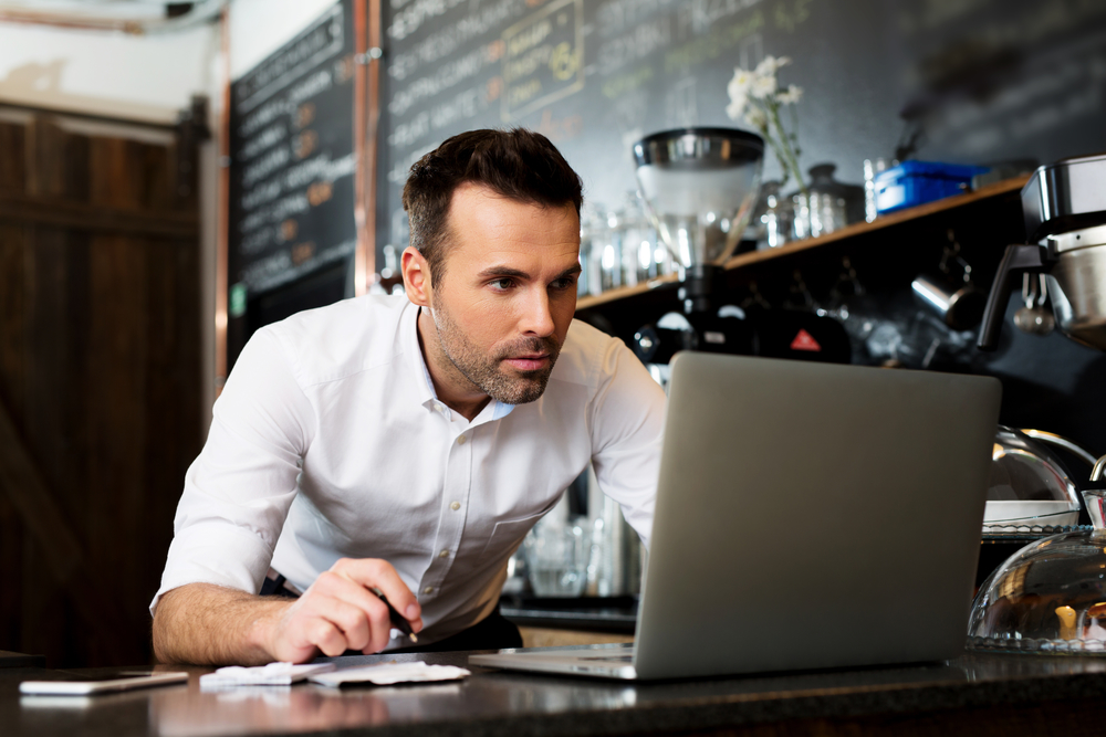 Man researching restaurant management tips