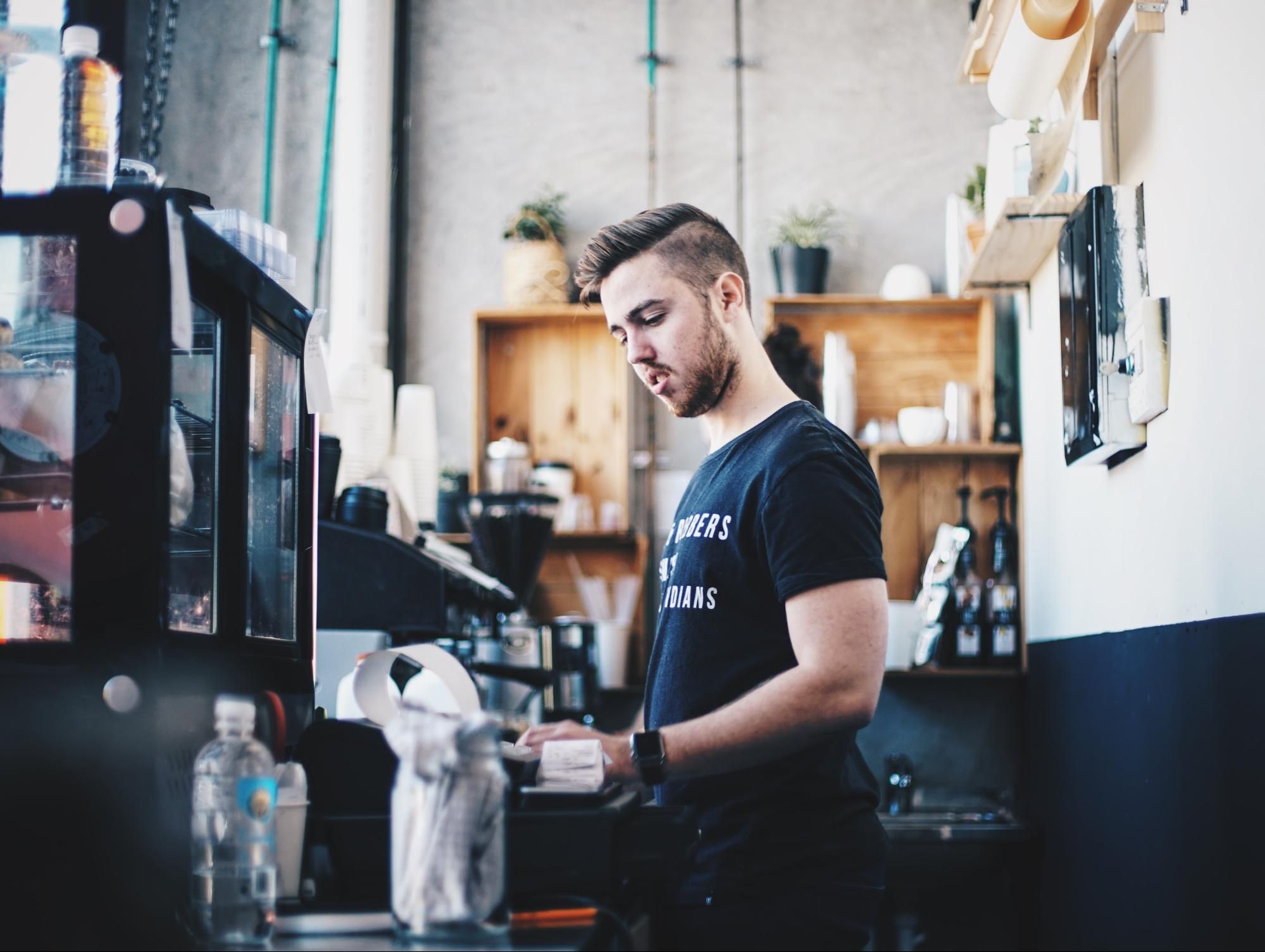 Barista working at his job