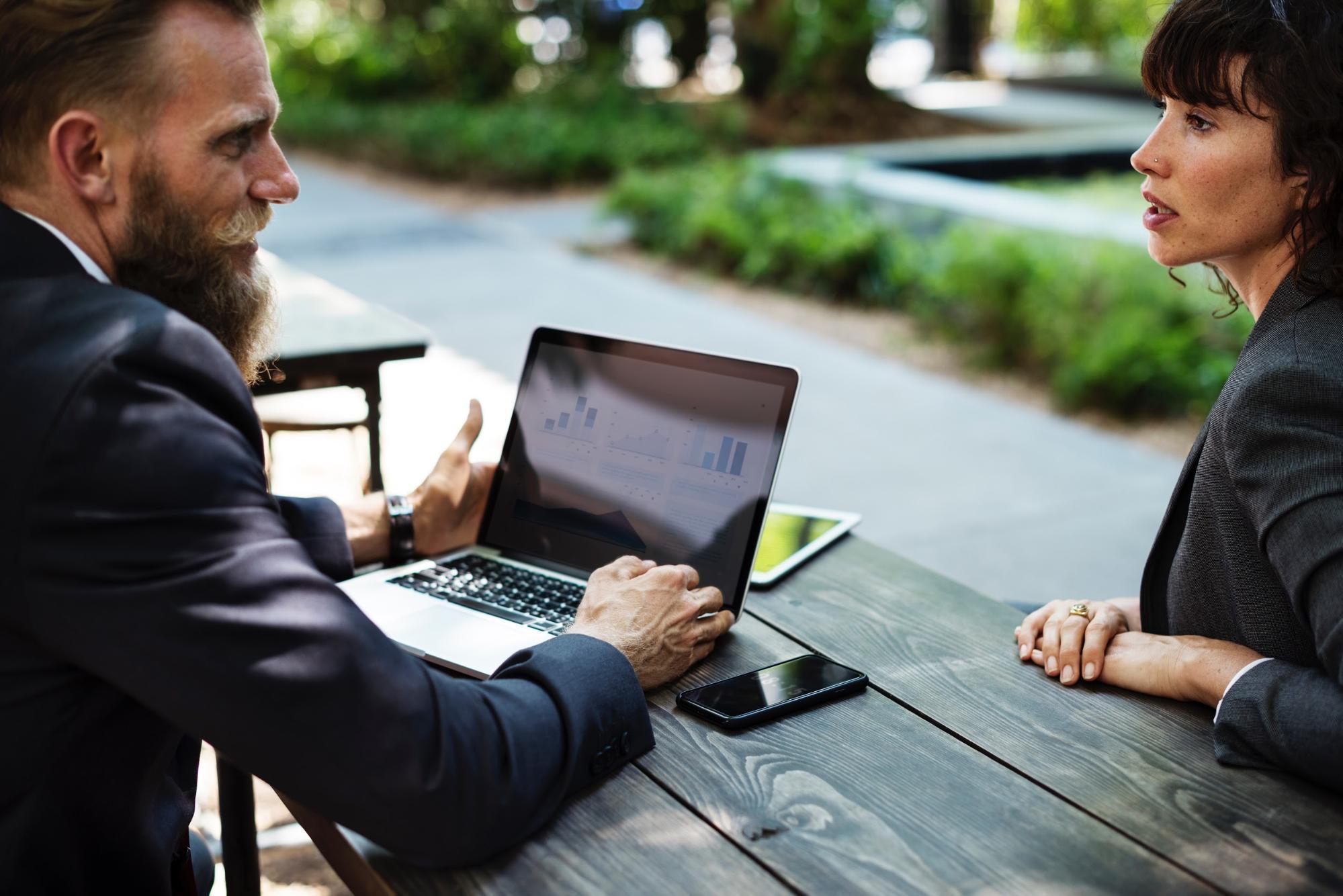 Professionals discussing a retail manager résumé