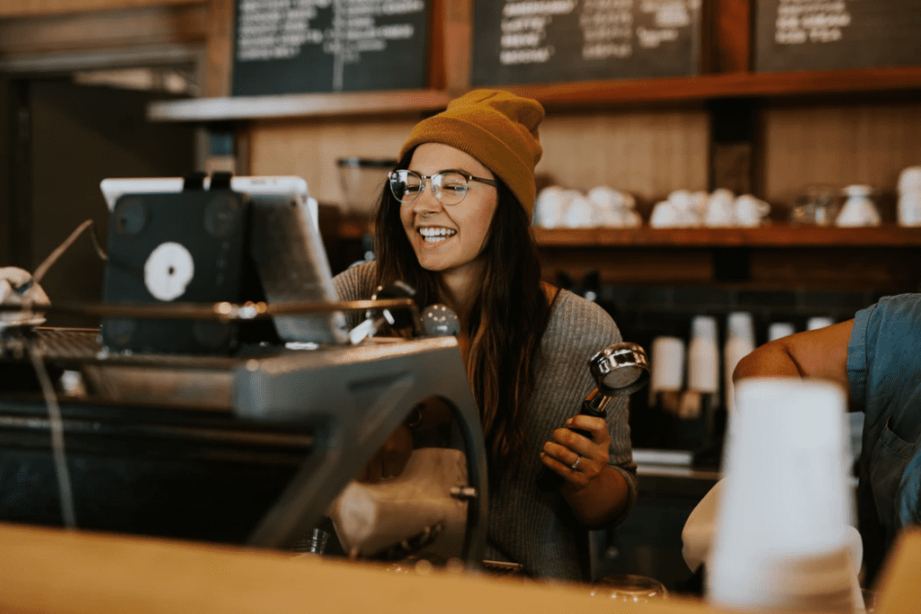 Woman working at a coffee shop as the restaurant manager