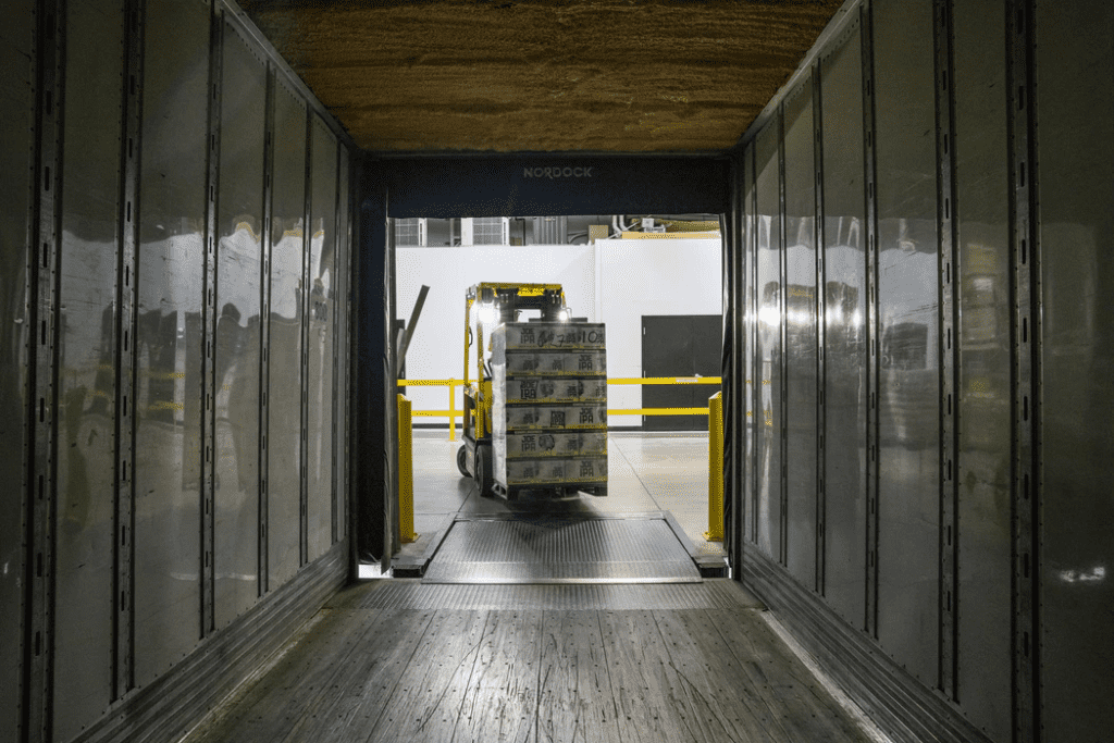 using a forklift to move different types of inventory