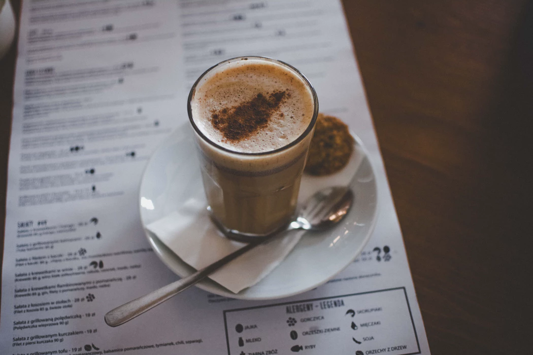 Coffee drink on top of a restaurant menu