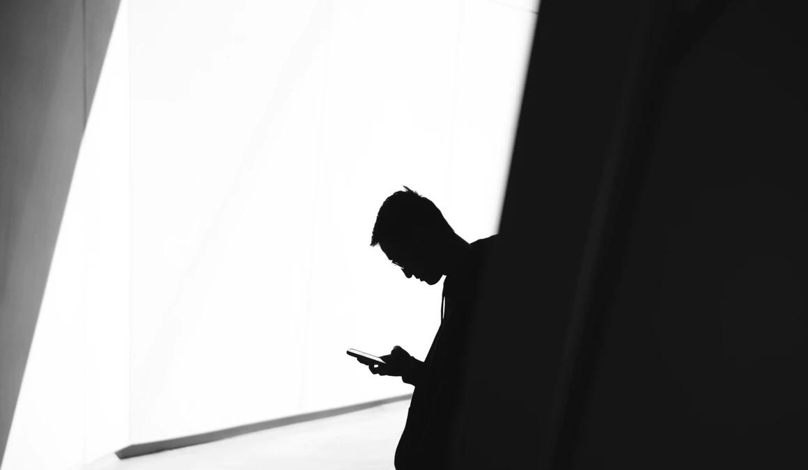 Disgruntled employee on his phone