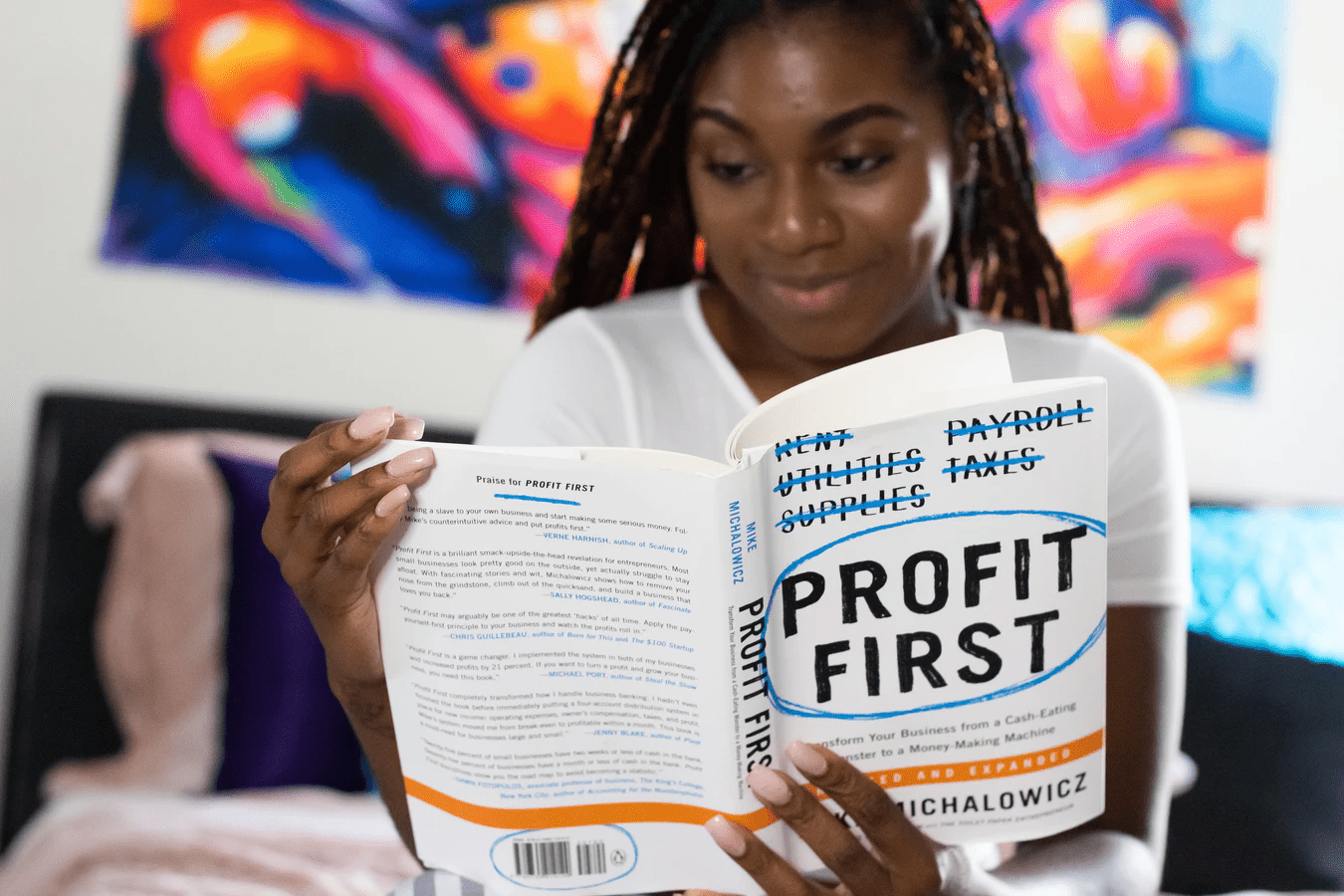Woman reading Profit First