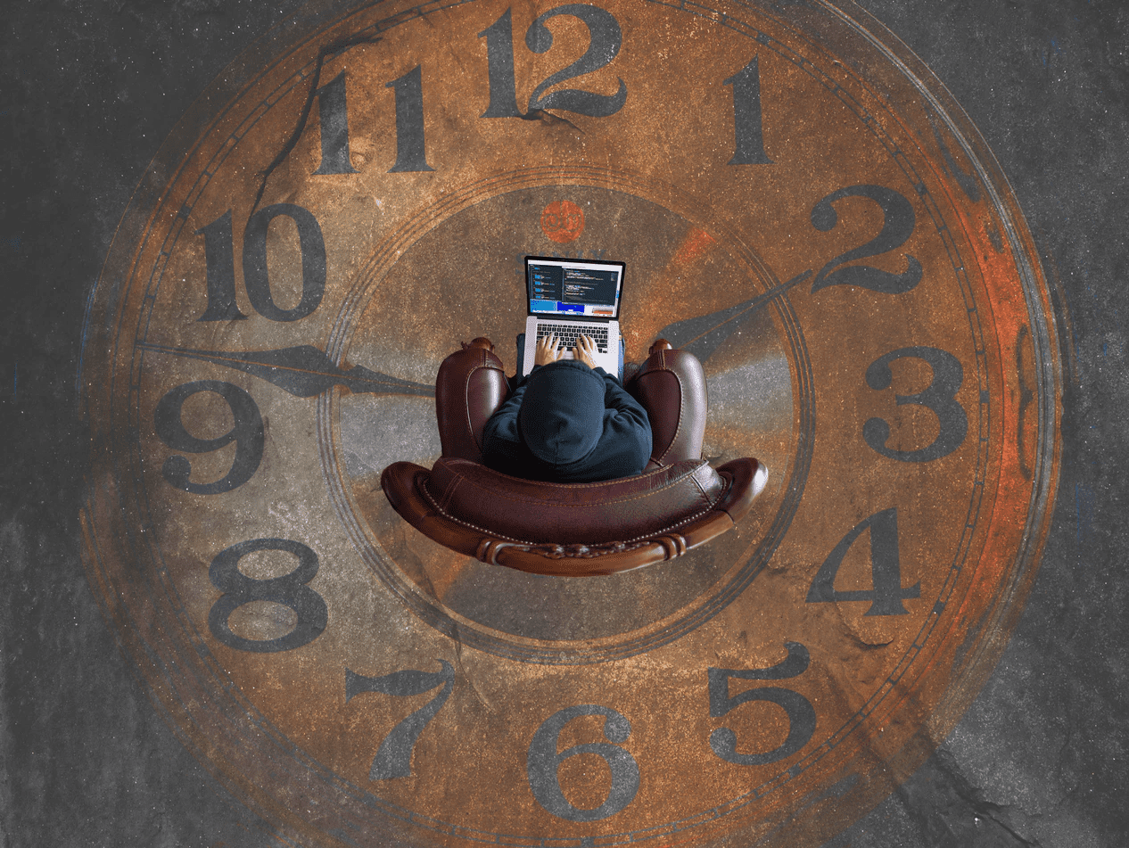 Person sitting in the middle of a clock painting on ground
