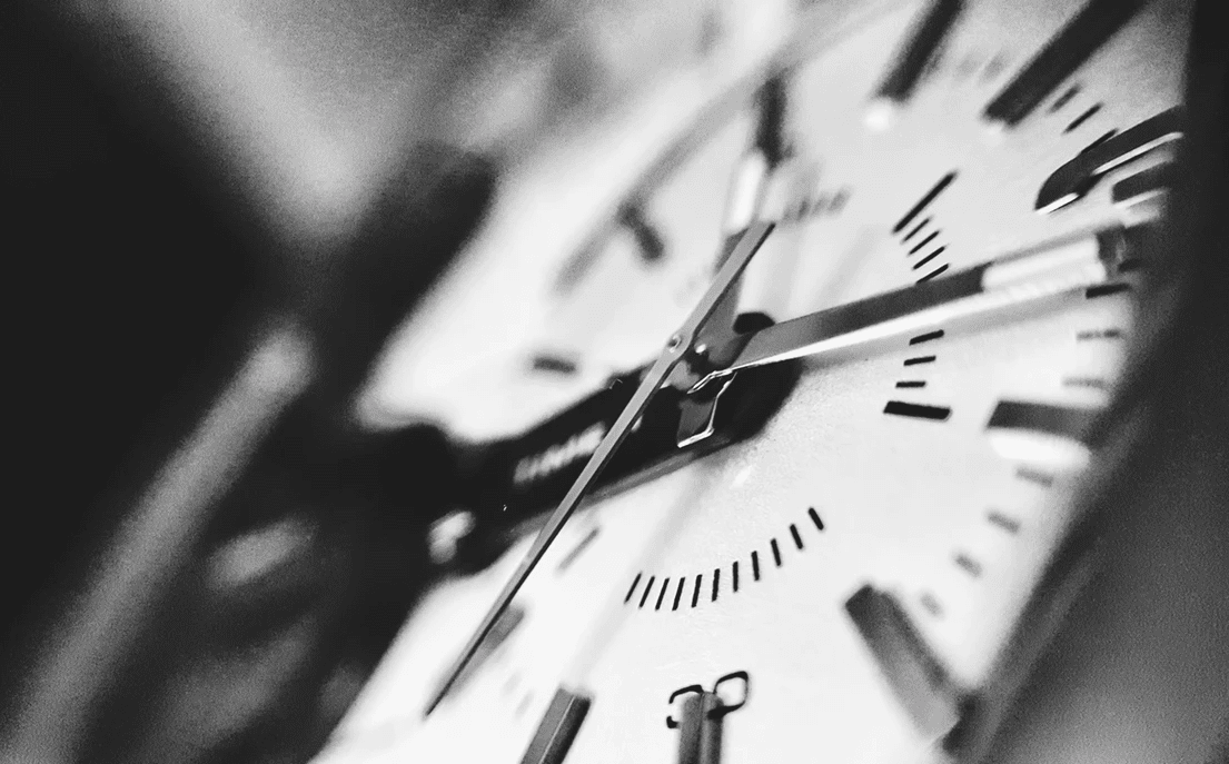 black and white picture of a clock face