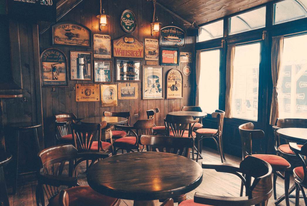 Empty old-fashioned restaurant with wood paneling and wooden tables and chairs