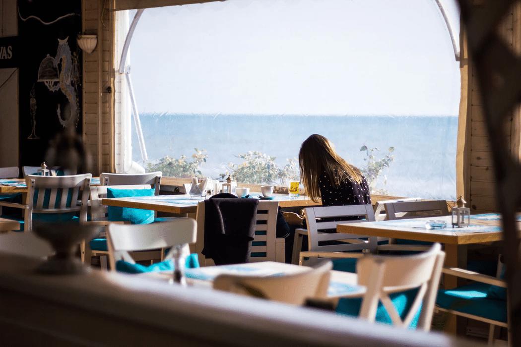 woman working an alternative work schedule at a restaurant