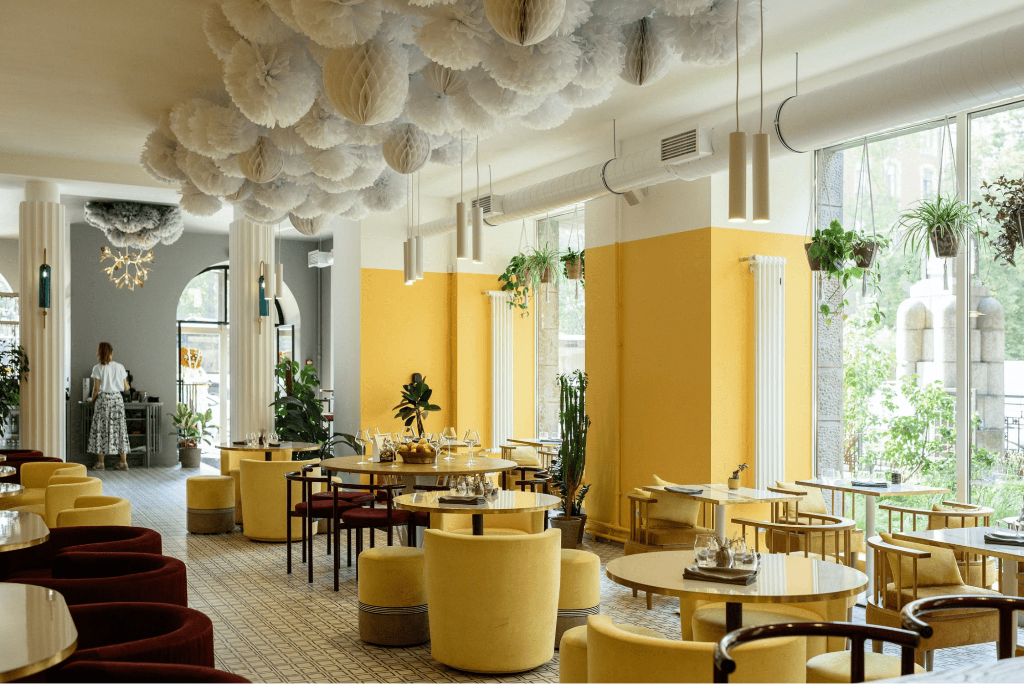 Restaurant with yellow decor and round tables