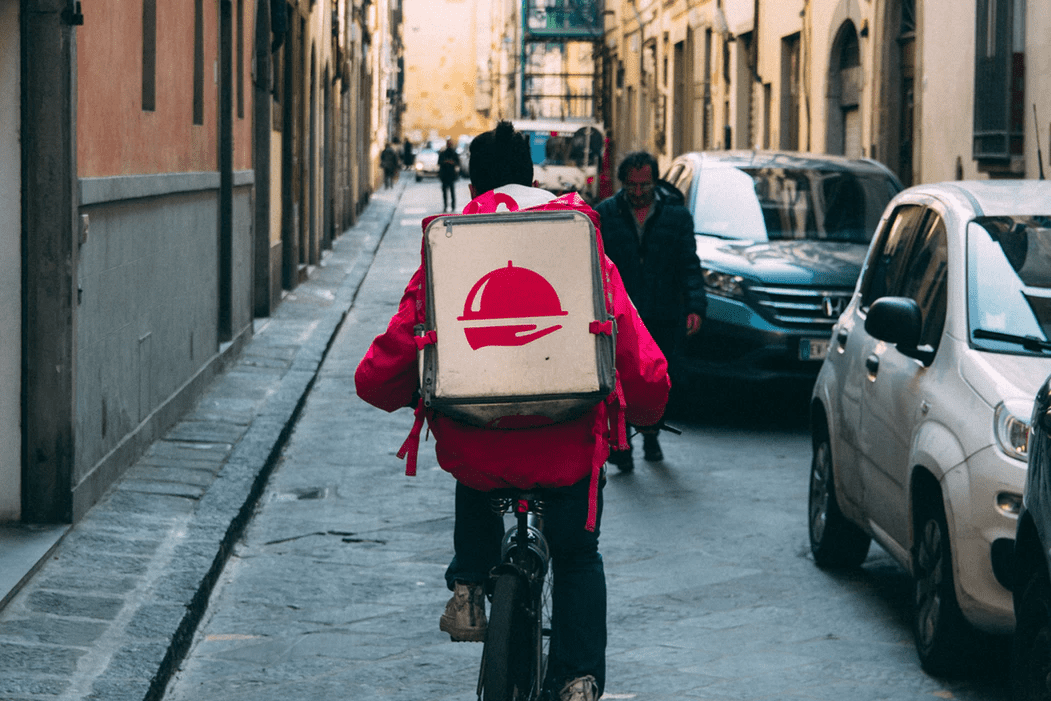 Man delivering food on a bike