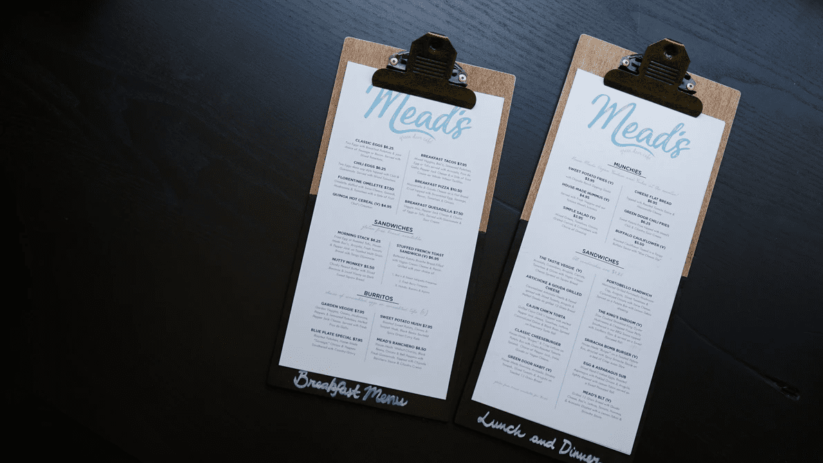Two menus on clipboards with black background
