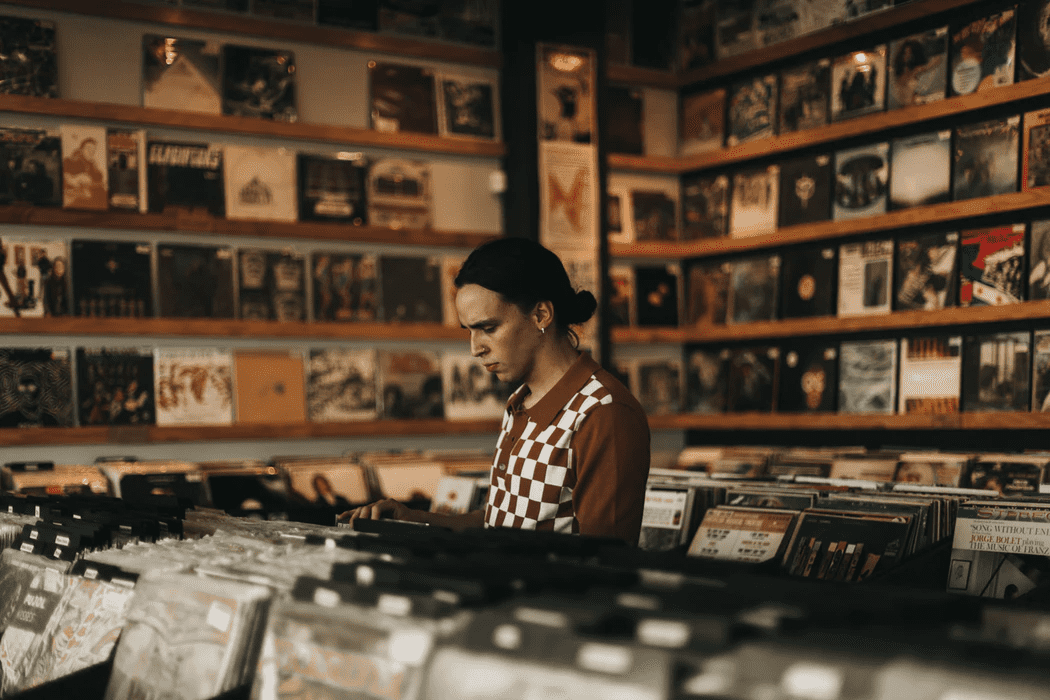 Person working at a record store