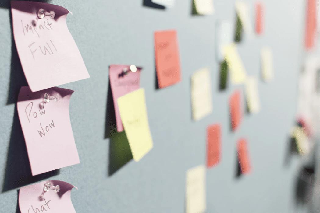 sticky notes on an office bulletin board
