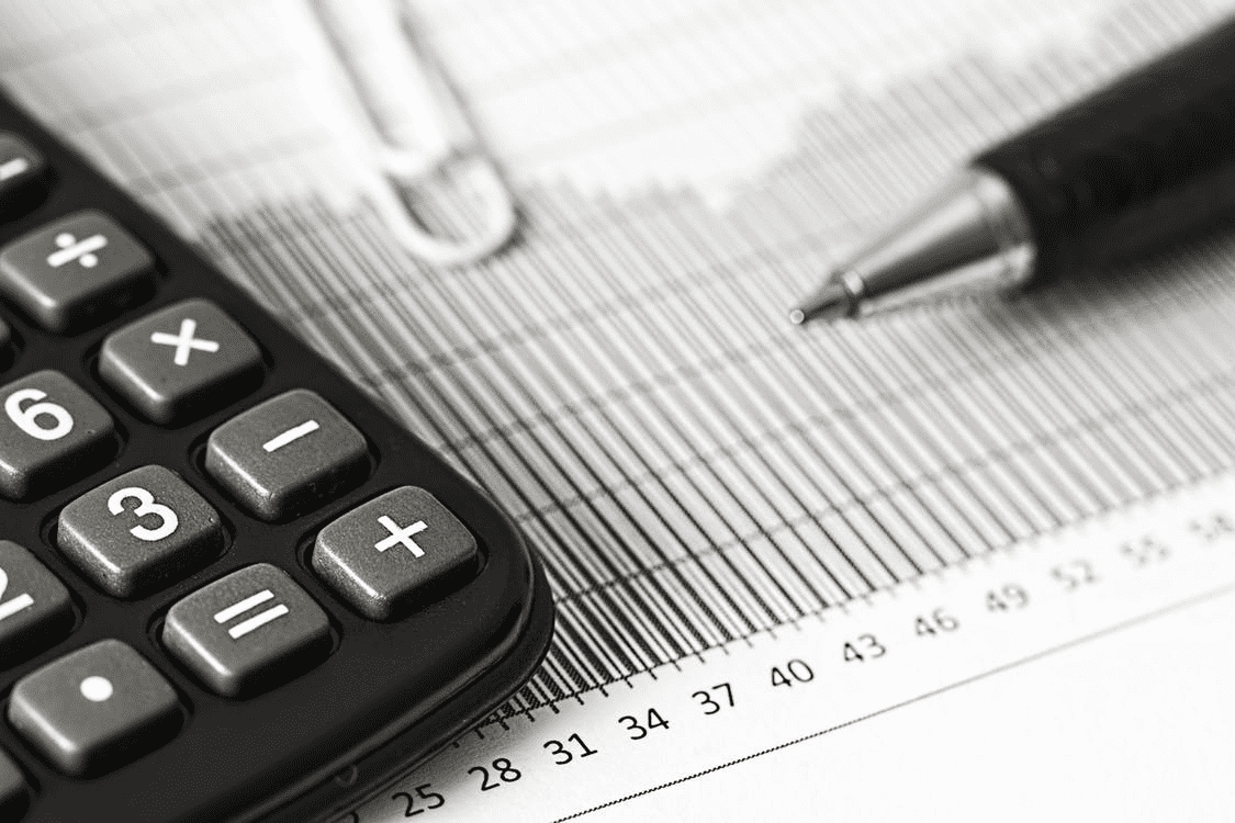 Pen and calculator on a graph of PTO accrual