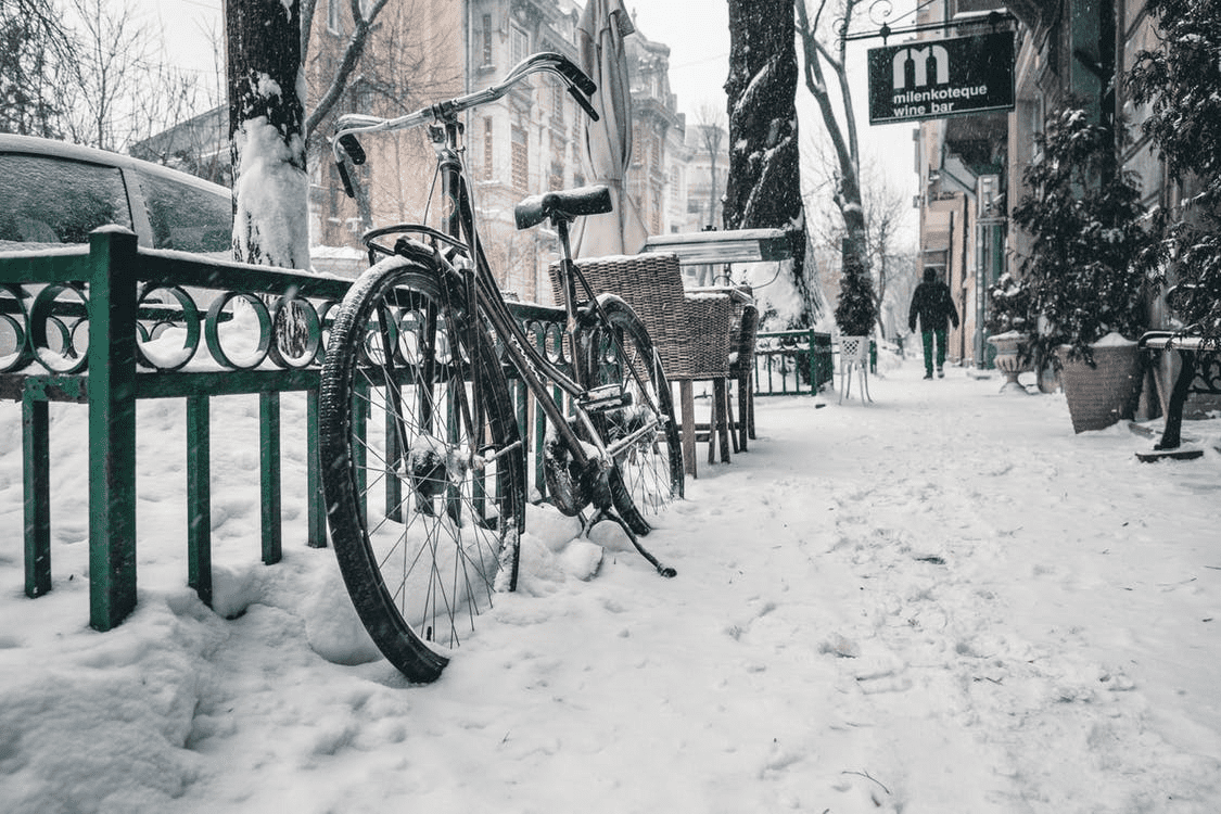 bike on a street in the snow