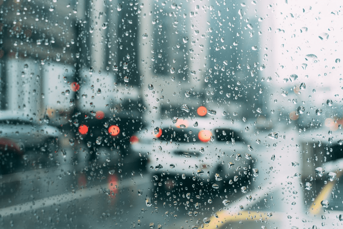 raindrops on a window looking out on cars