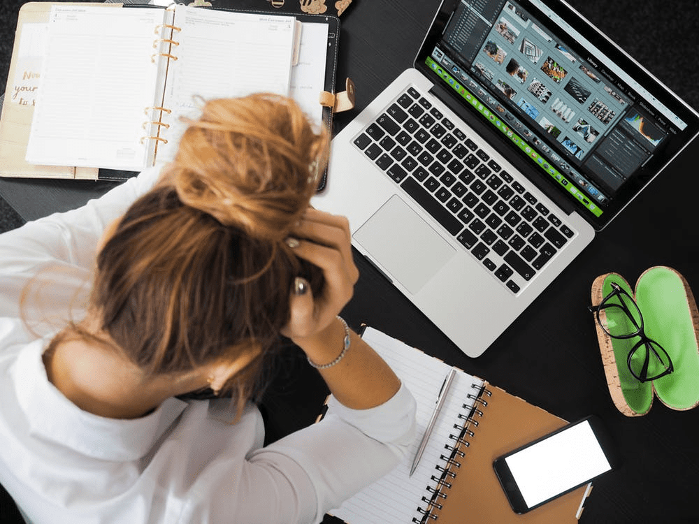 woman with her laptop experiencing employee burnout