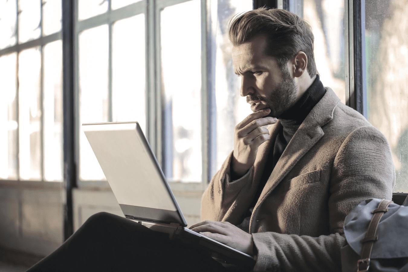 Man on laptop writing a restaurant business plan