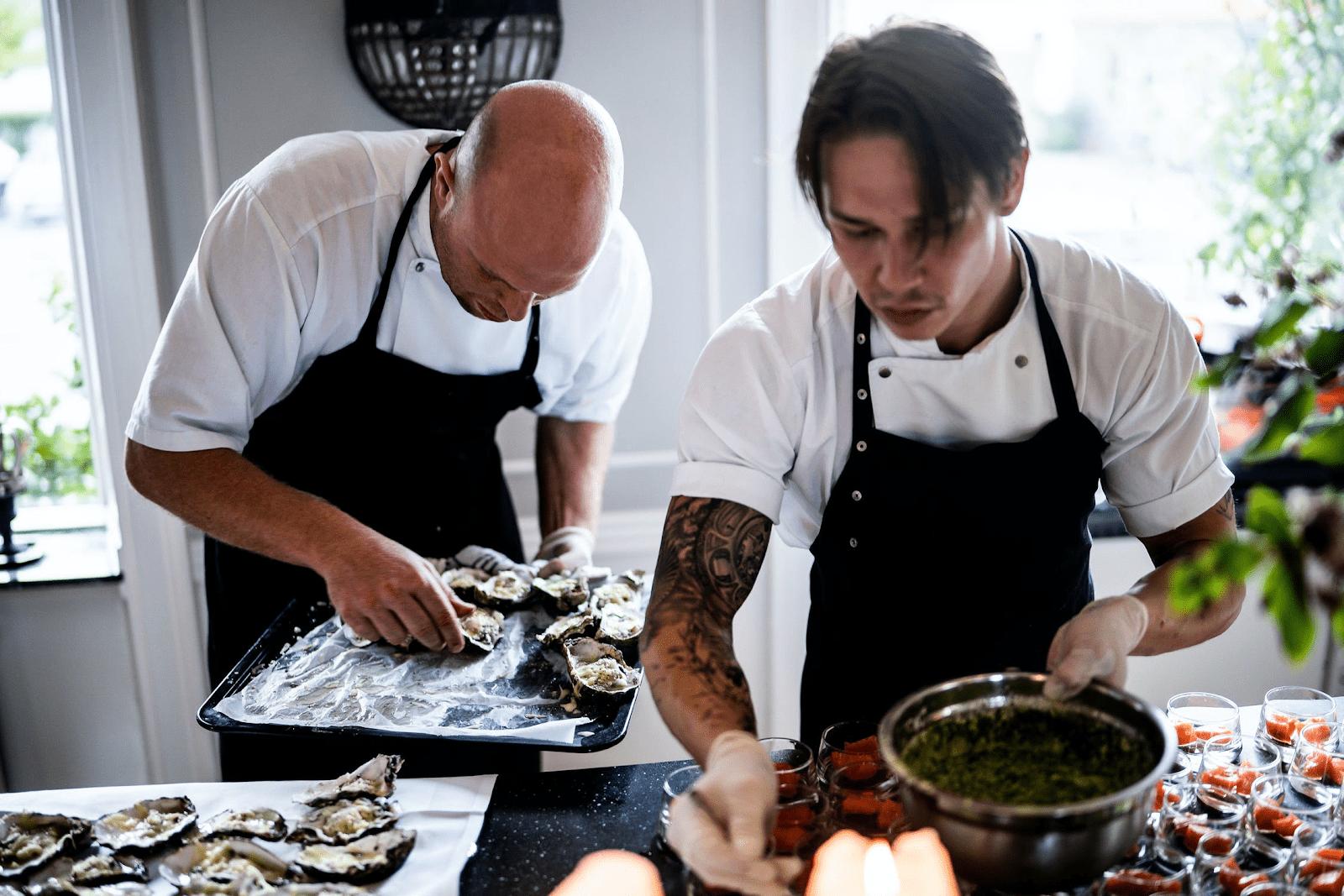 coworkers preparing food in a restaurant