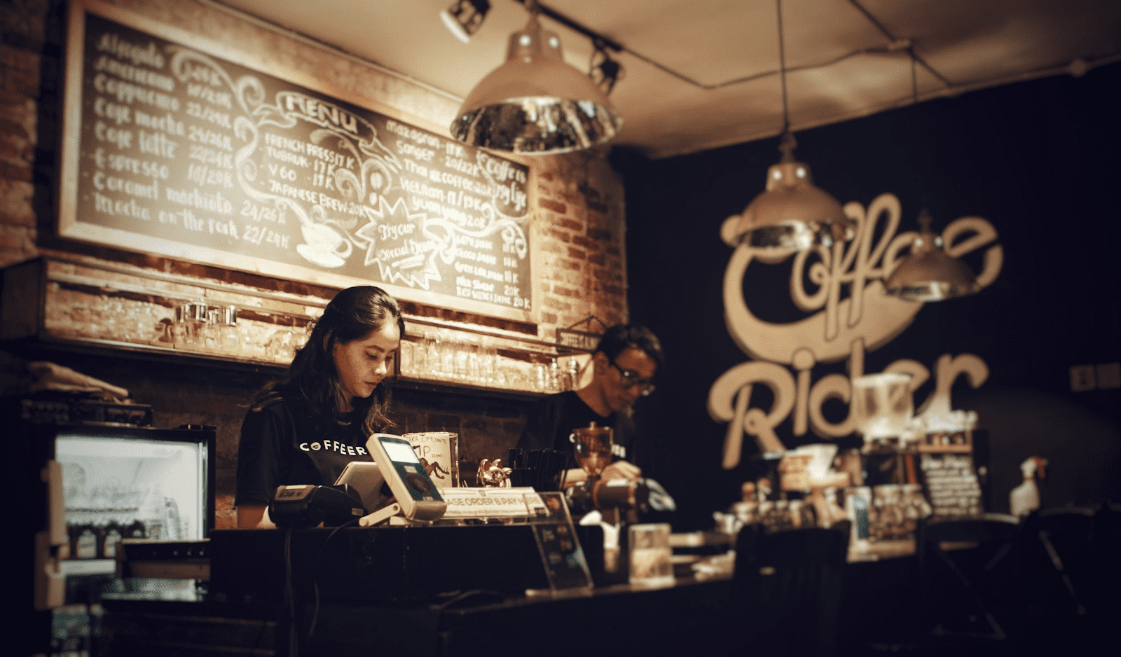 baristas working at a coffee shop