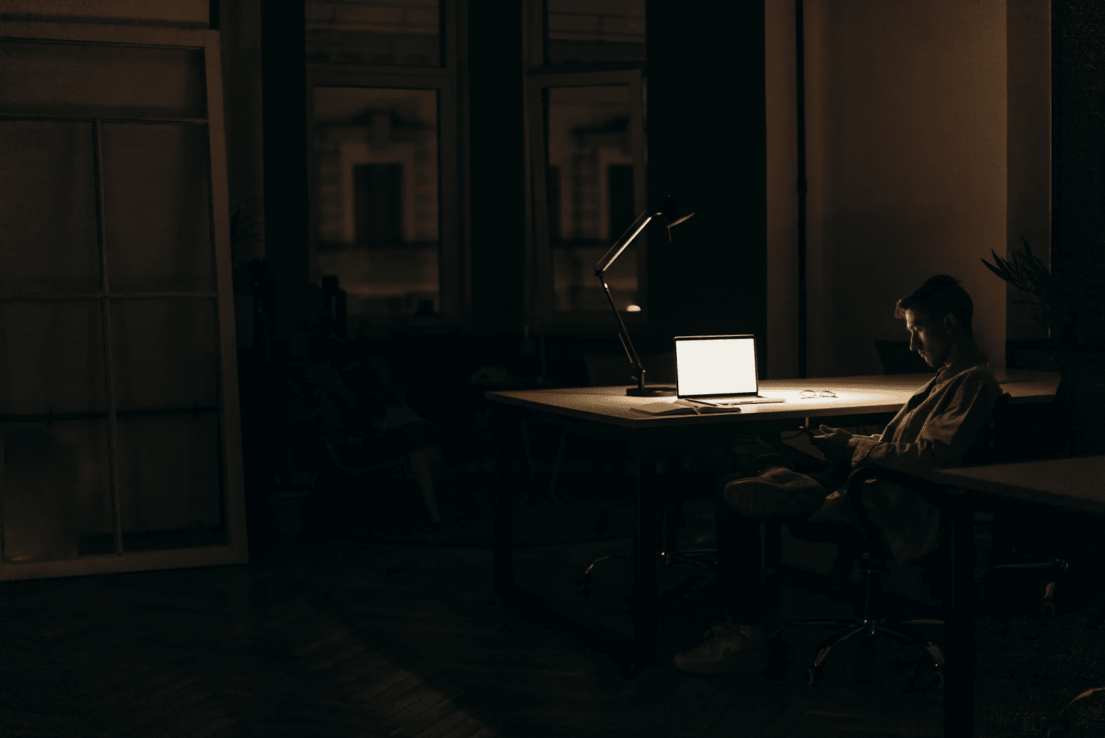 man working from his home office at night as part of a flex schedule