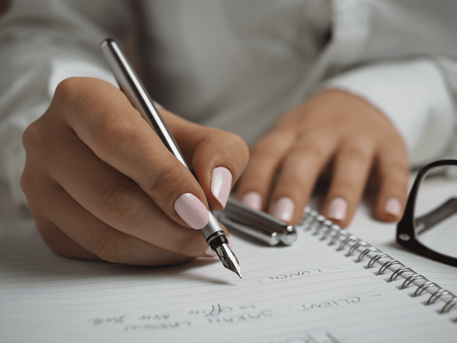 business owner creating a seasonal schedule using a pen and notepad