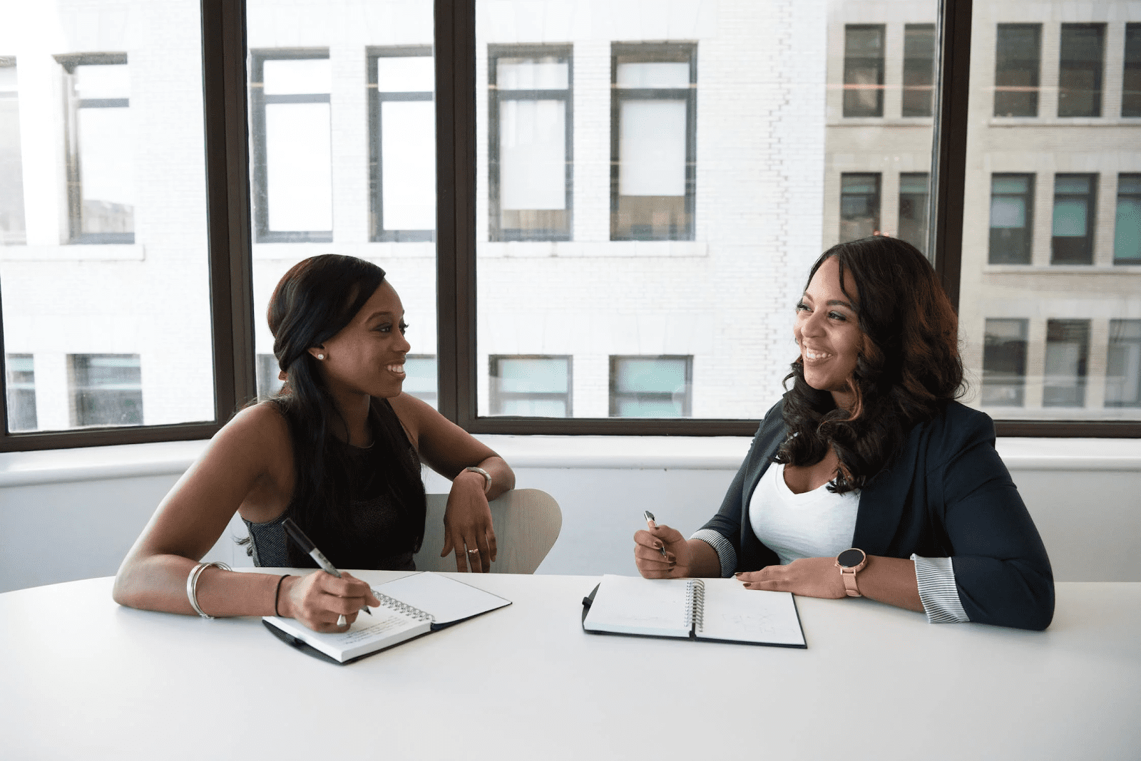 female business owner discussing human resources functions