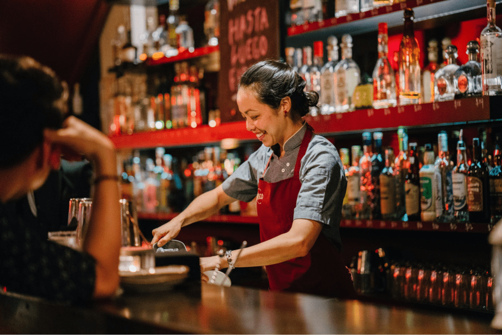 Bartender serving up a drink to increase customer loyalty