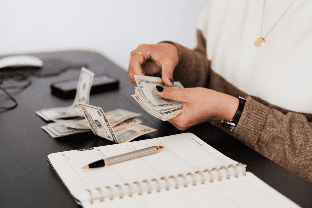 Employee counting cash in net pay
