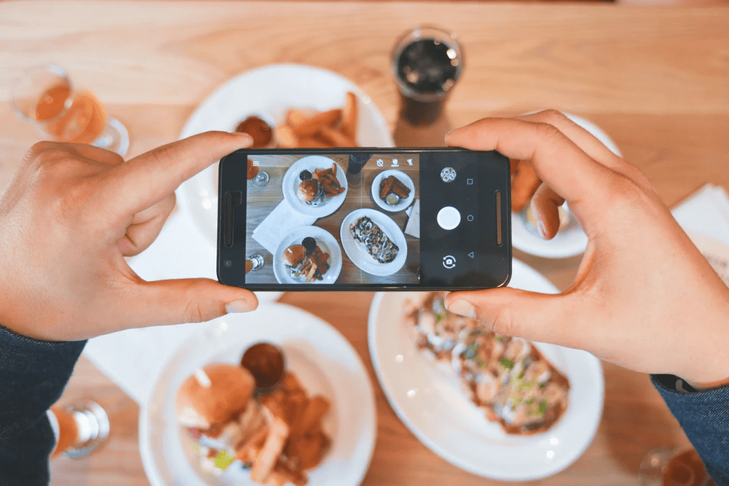 taking food pictures for restaurant social media marketing
