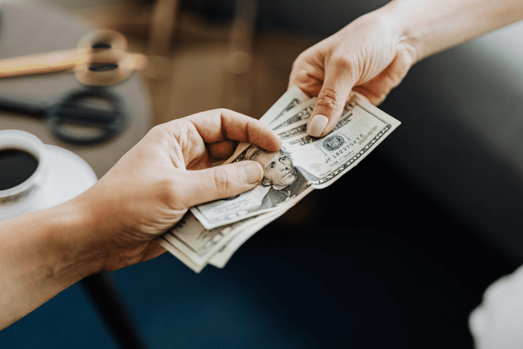 Customer handing server cash