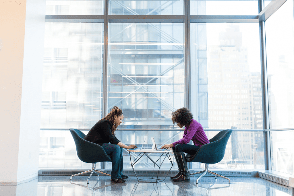 two employees discussing ideas for diversity activities