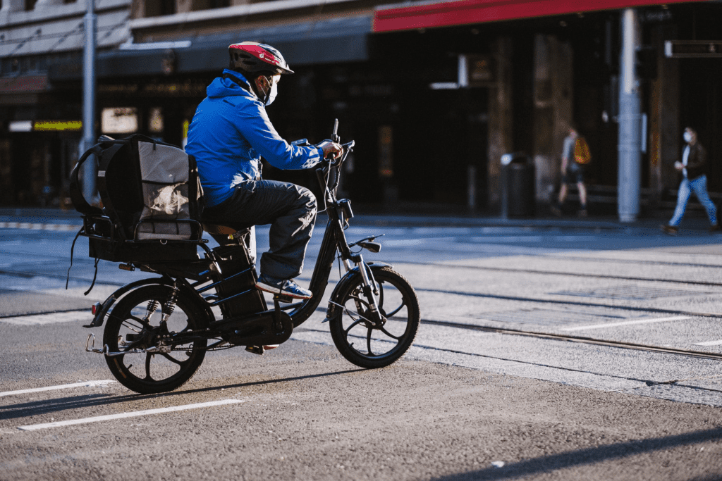 Man riding a bike for delivery service