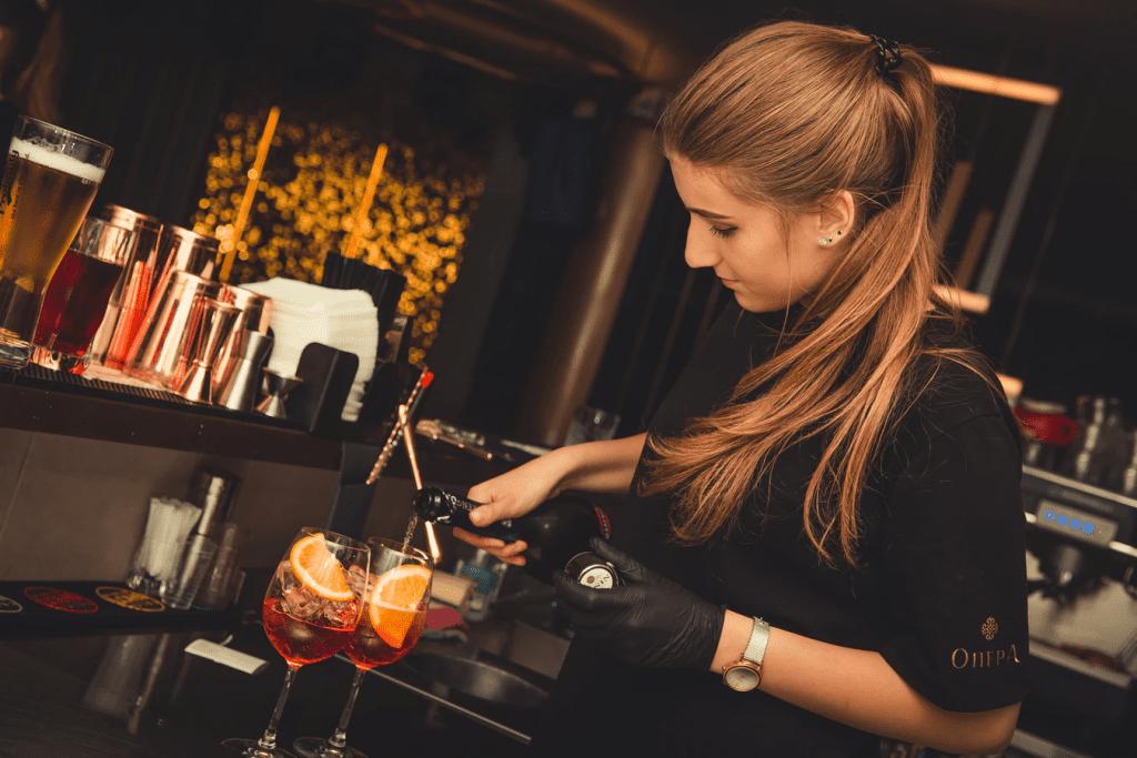 Bartender serving up sangria behind the bar