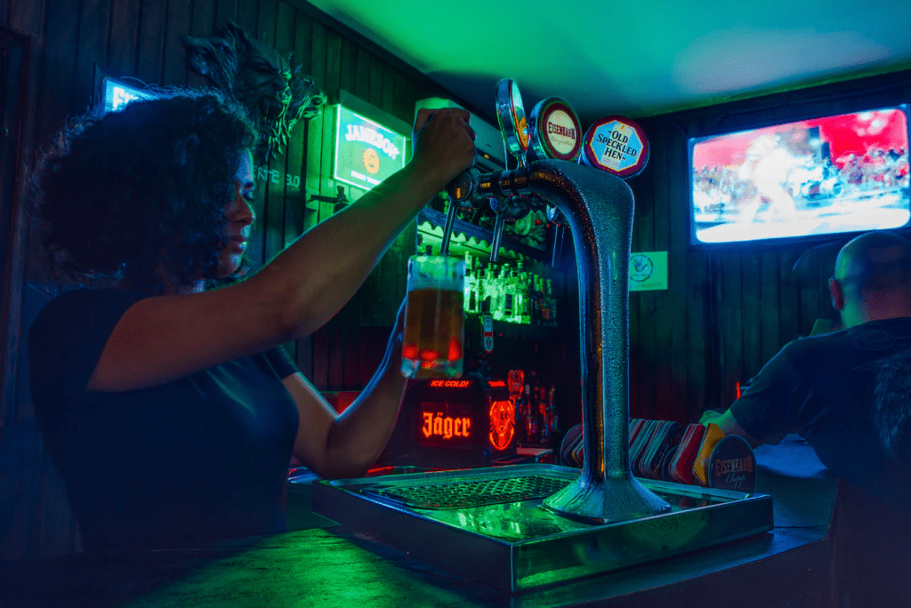 Bartender pouring a beer after using suggestive selling