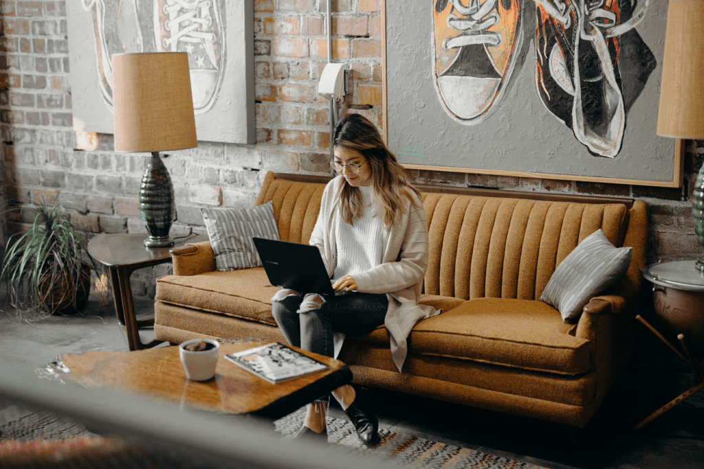 Woman working on her own laptop at coffee shop