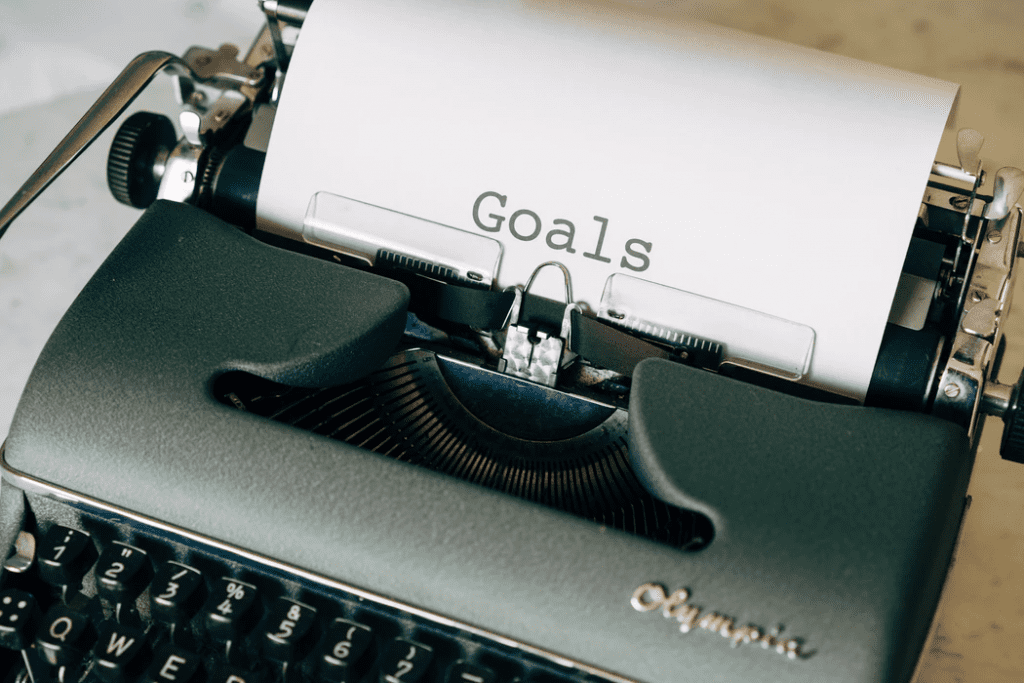 Type writer with business goals list