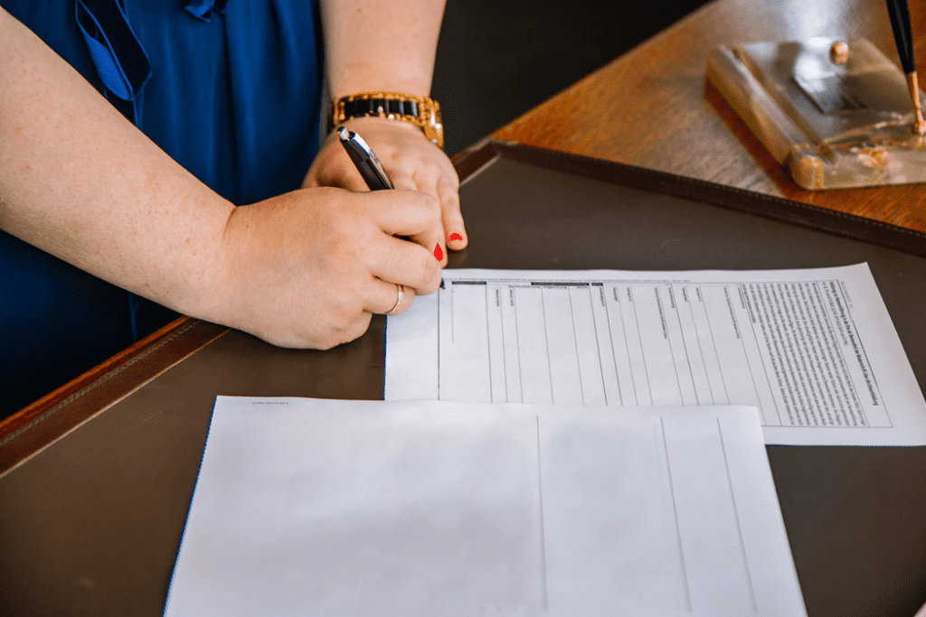 Woman filling out employee application form
