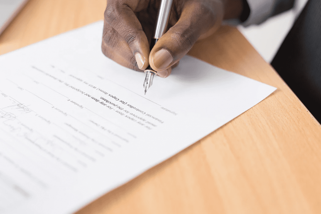 Person filling out employee application form