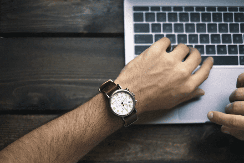 Man using his watch for employee time tracking