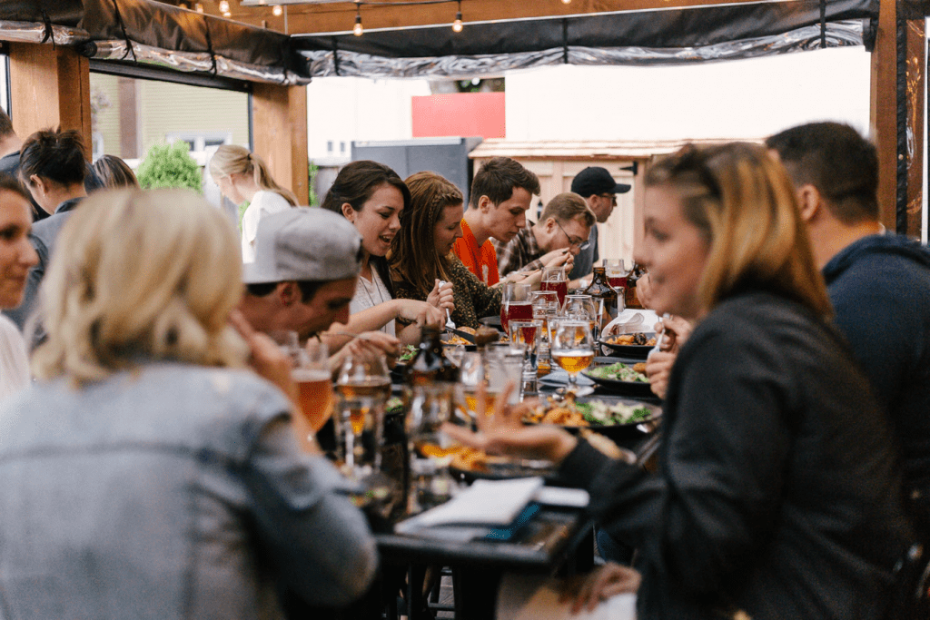 Customers at dinner enjoying the restaurant loyalty programs
