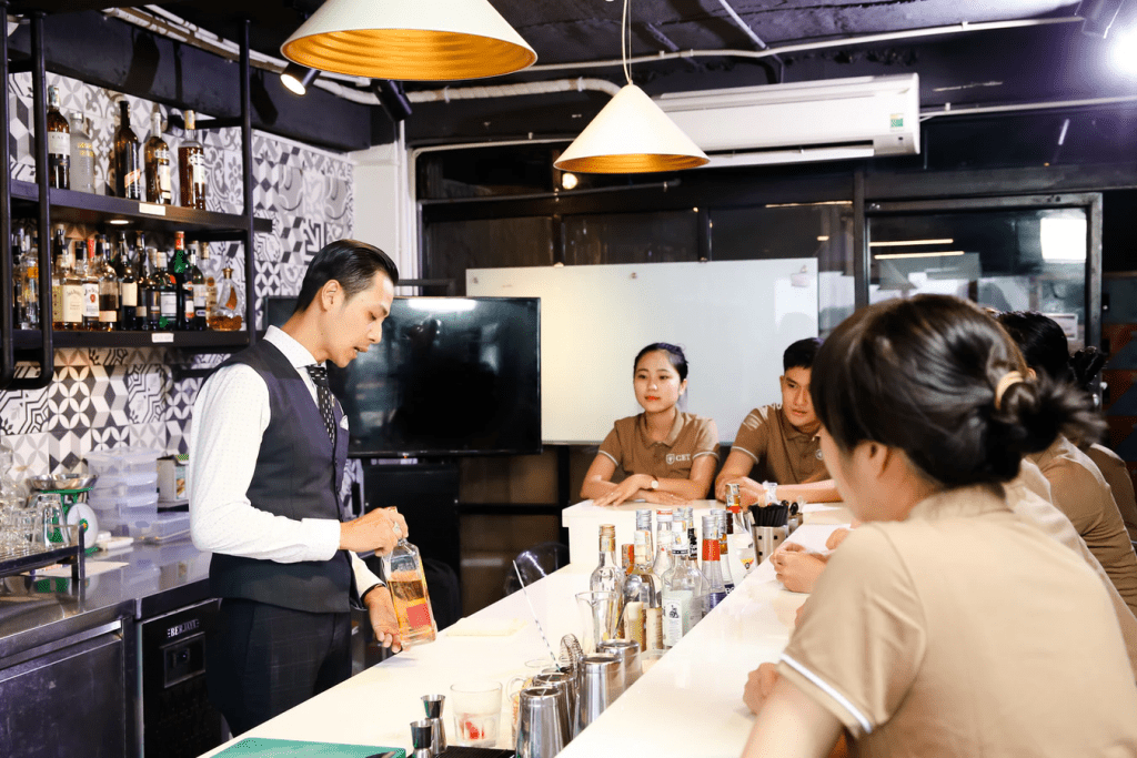 salaried employees learning how to make cocktails