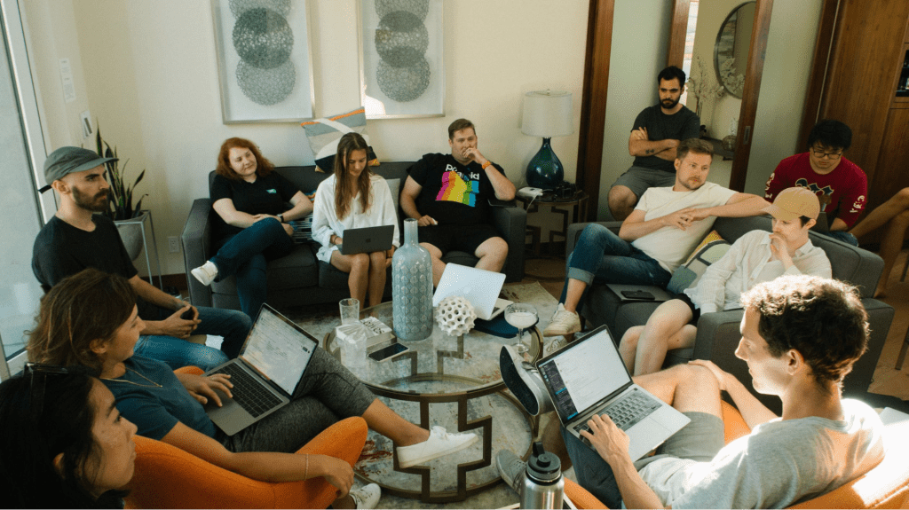 team-building questions being asked with a group of coworkers