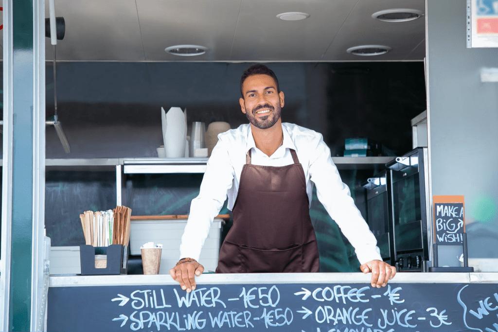 Barista standing in coffee shop truck