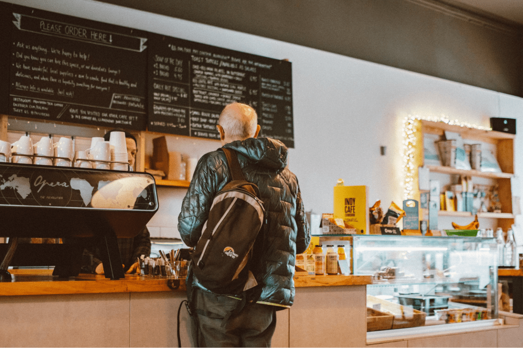 man ordering at a coffee shop