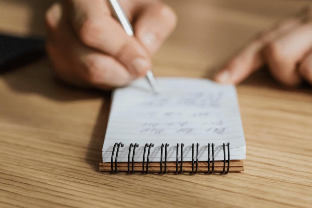 Notes being taken on paper